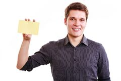 Young man with piece of paper. Royalty Free Stock Image