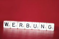 Advertisement cubes. Cube with letters on a red background Stock Photography