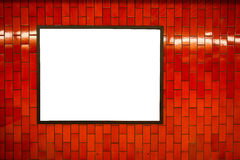 Advertisement empty poster space frame on the brick red wall on subway station Stock Images