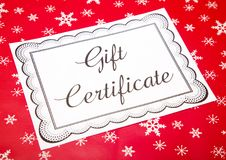 Advertisement for Gift Certificates. On a Red Snowflake Background stock photos