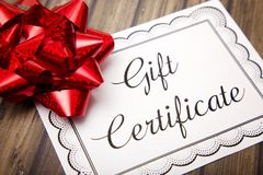 Advertisement for Gift Certificates. On a Wooden Table royalty free stock photo