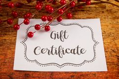 Advertisement for Gift Certificates. An Advertisement for Gift Certificates on a Wooden Table stock images