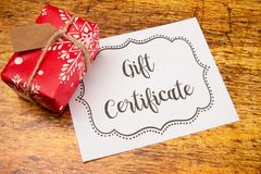 Advertisement for Gift Certificates. An Advertisement for Gift Certificates on a Wooden Table royalty free stock photo