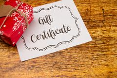 Advertisement for Gift Certificates. An Advertisement for Gift Certificates on a Wooden Table royalty free stock images