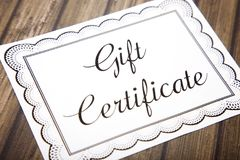 Advertisement for Gift Certificates. On a Wooden Table stock image