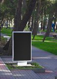 Advertisement hoarding. Empty white advertisement hoarding on a lawn Royalty Free Stock Photo