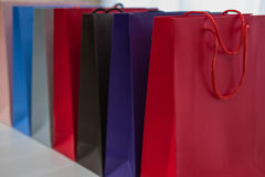 Advertisement and retail concept - many colorful shopping bags Stock Image