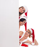 Advertisement and sale concept three  happy women in santa help Stock Photo