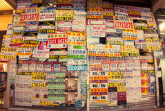 Advertisement stickers on an abandoned store at Ladies& x27; Market Street in Hong Kong Royalty Free Stock Image