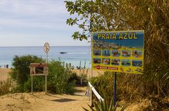 An advertisement for water sports pursuits at the entrance to the Praia Azul beach in Albuferia in Portugal. Royalty Free Stock Photography