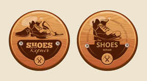 Advertisement wood panels for shoes repair workshop Stock Photo