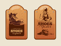 Advertisement wood panels for shoes repair workshop Royalty Free Stock Photo
