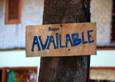 Advertisement on a wooden board ` Room available` Royalty Free Stock Photo