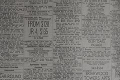Advertisements for rental properties in old newspaper stock photography