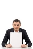 Advertiser. Image of confident businessman showing blank paper and looking at camera Stock Photos