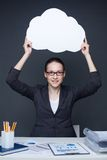 Advertiser. Portrait of young smiling female holding paper speech bubble and looking at camera Stock Images