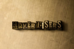 ADVERTISERS - close-up of grungy vintage typeset word on metal backdrop Stock Photo