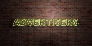 ADVERTISERS - fluorescent Neon tube Sign on brickwork - Front view - 3D rendered royalty free stock picture Royalty Free Stock Images