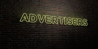 ADVERTISERS -Realistic Neon Sign on Brick Wall background - 3D rendered royalty free stock image Stock Photos