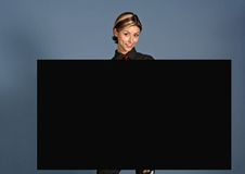 Advertising. A young woman with a black shield royalty free stock photography