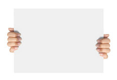 Advertising. Hand hold on a paper ready for your design Royalty Free Stock Photos