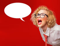 Advertising. Facial woman screaming in blank speech, isolated on red Royalty Free Stock Images