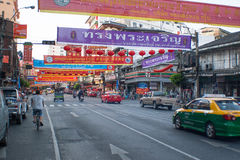 Advertising banners with Chinese lanterns. Street decoration for chinese new year celebration. Chinatown, Bangkok, Thailand Stock Photos