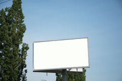 Advertising billboard. Billboard on the background of trees Stock Photography