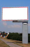Advertising billboard #3. Big side advertising billboard with an isolated blank space for your ad. City background: shallow DOF Stock Photos
