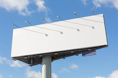 Advertising billboard. On a background of blue sky with clouds royalty free stock images