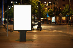 Advertising billboard. Blank advertising billboard in the city at night stock photography