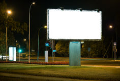Advertising billboard. Blank advertising billboard in the city at night royalty free stock images