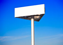 Advertising billboard on a blue morning sky Stock Image