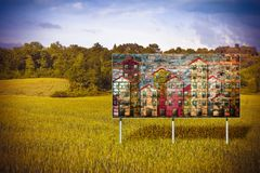 Advertising billboard, immersed in nature, informs the construction of a new residential area.The image on the billboard is my royalty free stock photo