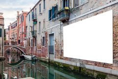 Advertising billboard in Venice. Blank horizontaly oriented billboard with copy space on the wall in Venice, Italy royalty free stock image