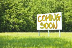 Advertising billboard with written `Coming Soon` on it.  Stock Photography