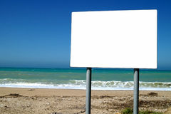 Advertising board on background ocean and sky Royalty Free Stock Photos