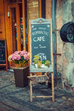 Advertising board and flowers in Riga, Latvia Royalty Free Stock Photography