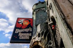Advertising boarding seen attached to a castle, depicting a famous horror character. stock image
