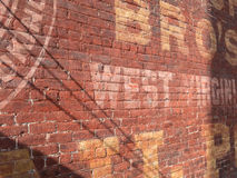 Advertising on brick wall Stock Photography