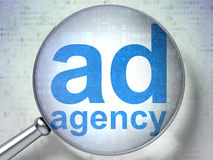 Advertising concept: Ad Agency with optical glass Royalty Free Stock Images