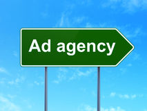 Advertising concept: Ad Agency on road sign. Advertising concept: Ad Agency on green road (highway) sign, clear blue sky background, 3d render Stock Images