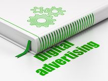 Advertising concept: book Gears, Digital Advertising on white background. Advertising concept: closed book with Green Gears icon and text Digital Advertising on Royalty Free Stock Photography