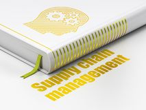 Advertising concept: book Head With Gears, Supply Chain Management on white background. Advertising concept: closed book with Gold Head With Gears icon and text Royalty Free Stock Images