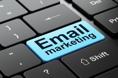 Advertising concept: Email Marketing on computer keyboard background. Advertising concept: computer keyboard with word Email Marketing, selected focus on enter Stock Photos