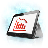Advertising concept: Decline Graph on tablet pc computer. Advertising concept: tablet pc computer with Decline Graph icon on display. Modern portable touch pad Royalty Free Stock Photos