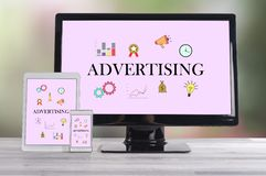 Advertising concept on different devices. Advertising concept shown on different information technology devices royalty free stock photo