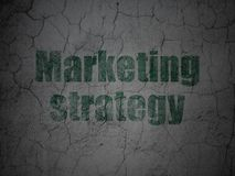 Advertising concept: Marketing Strategy on grunge wall background. Advertising concept: Green Marketing Strategy on grunge textured concrete wall background Royalty Free Stock Photos