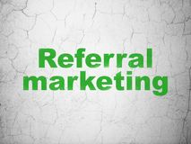 Advertising concept: Referral Marketing on wall background. Advertising concept: Green Referral Marketing on textured concrete wall background royalty free stock photos