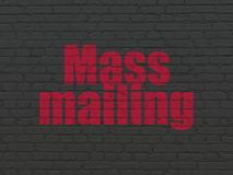 Advertising concept: Mass Mailing on wall background. Advertising concept: Painted red text Mass Mailing on Black Brick wall background stock illustration